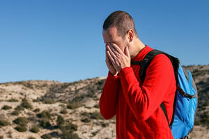 Man on a hike in pain
